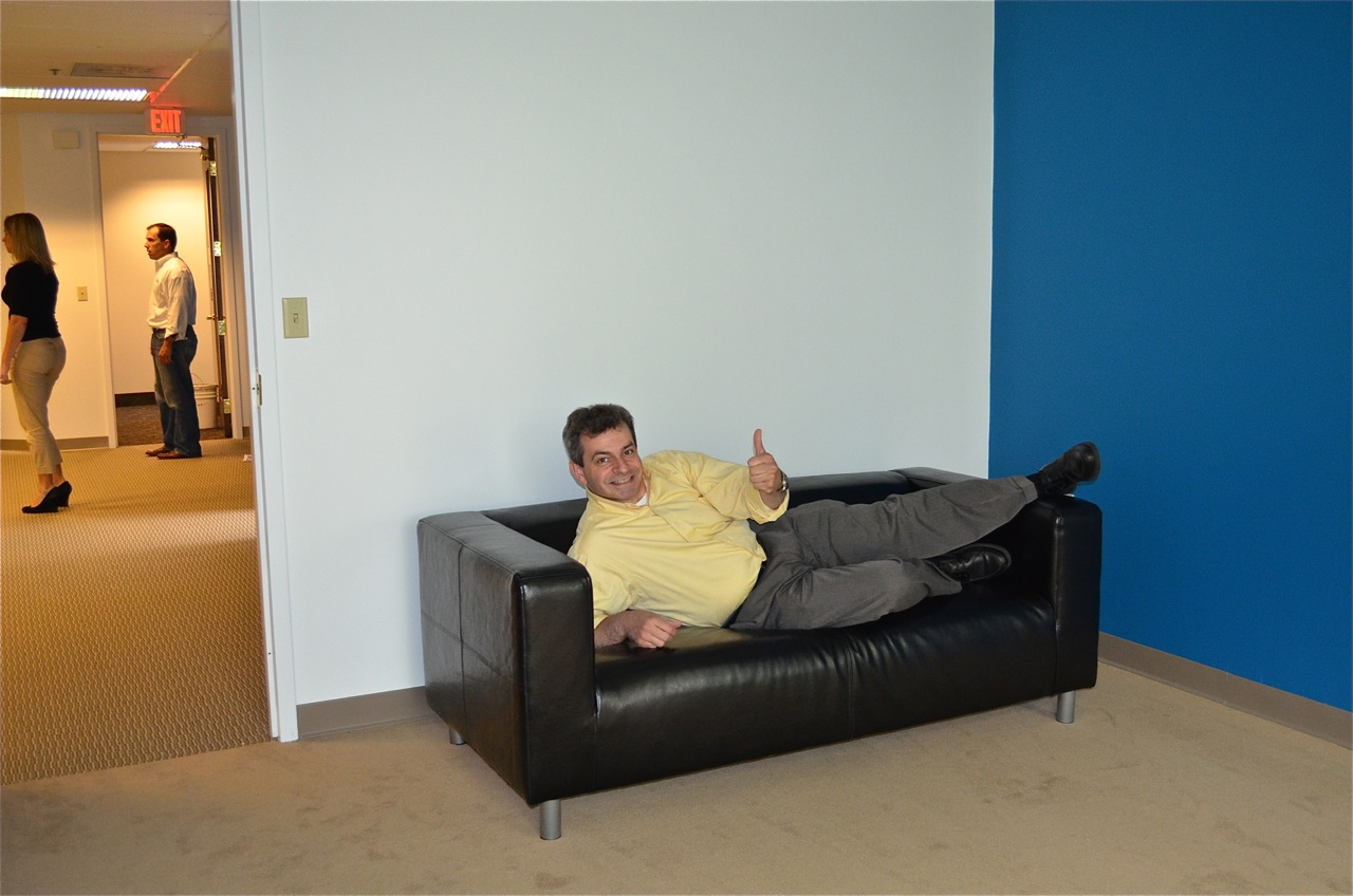UX Architect Kurt Penney tests the usability of the couch in President Wayne's office.